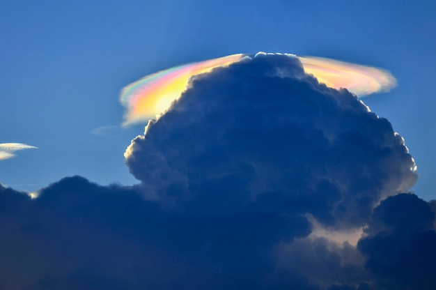 Fire rainbow cloud phenomenon is a natural phenomenon called irisation or iridescence. Premium Photo