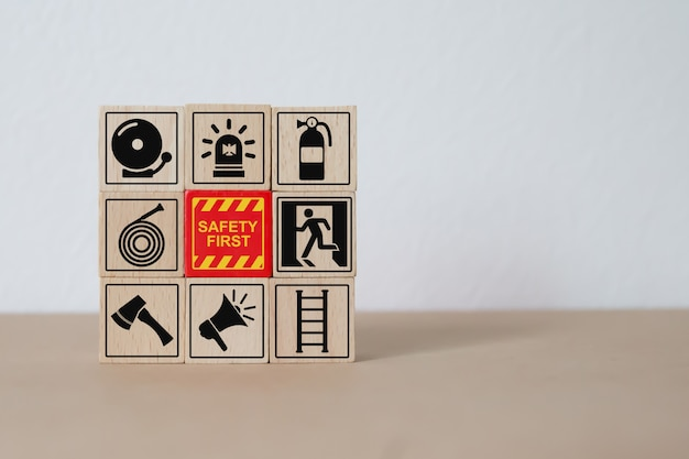 Fire and safety icons wood block stacking. Premium Photo