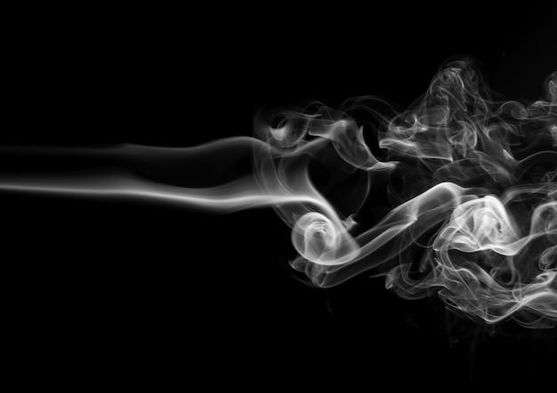 Fire of white smoke abstract on black background Premium Photo