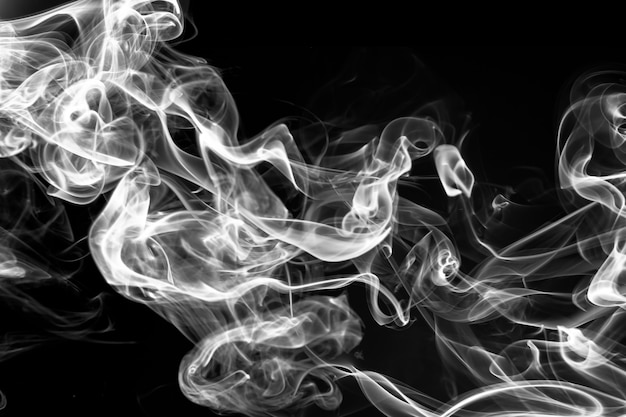 Fire of white smoke on black background. abstract movement Premium Photo