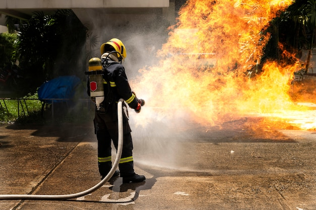Firefighters fighting the fire flame in an emergency situation. Premium Photo