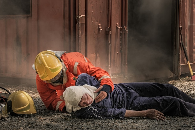 Firefighters save lives from fire by making cpr. Premium Photo