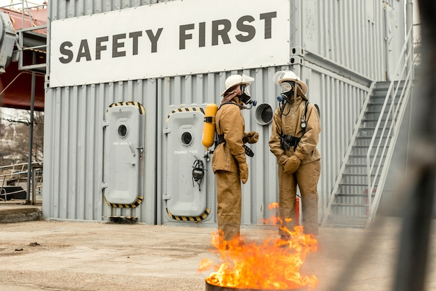 Firefighters use teamwork on a training how to stop fire Premium Photo
