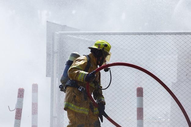 Fireman on the fire Premium Photo