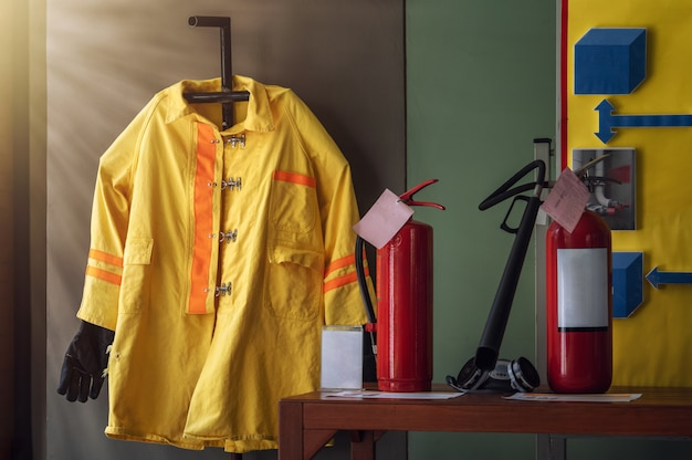 Fireman suit and equipment for training in basic fire fighting and evacuation simulation for safety in emergency situation Premium Photo