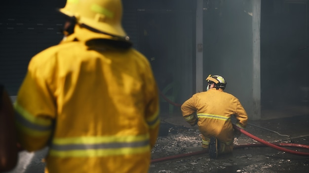 Fireman working real incident in thailand. Premium Photo