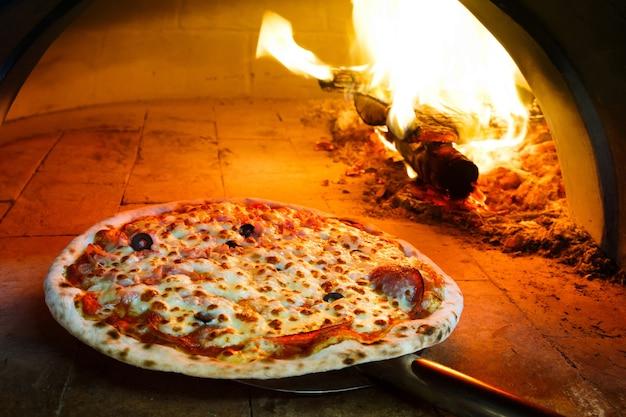 Firewood oven pizza Premium Photo