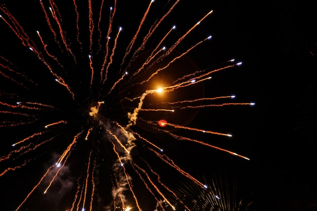 Fireworks fly like arrows in night sky Free Photo