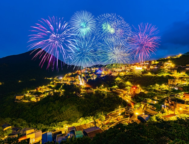 Fireworks over jiufen old street city at night, taiwan Premium Photo