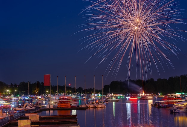 Fireworks of summer holiday in a city. Premium Photo
