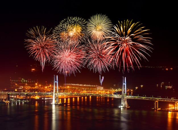Fireworks over yokohama bay bridge  at night, japan Premium Photo