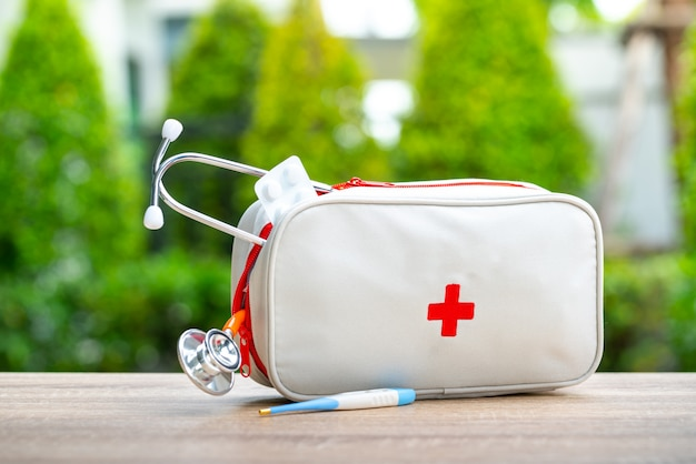 First aid kit bag in outdoor Premium Photo