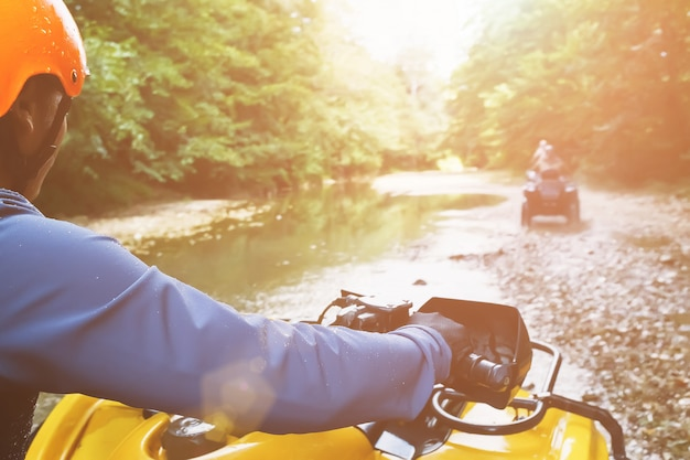 A first-person person driving an off-road atv, a view from the atv. Premium Photo