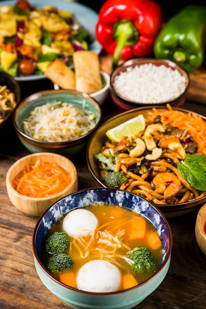 Fish ball soup and noodles bowl on wooden desk Free Photo