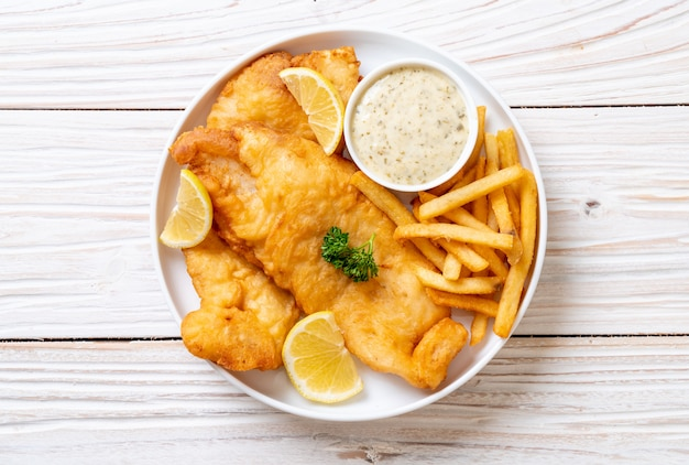 Fish and chips with french fries Premium Photo