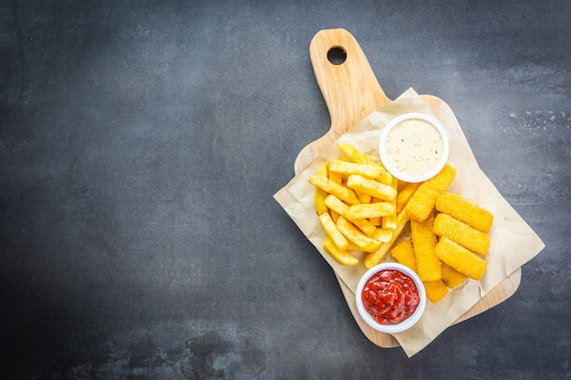 Fish finger and french fries or chips with tomato ketchup Free Photo