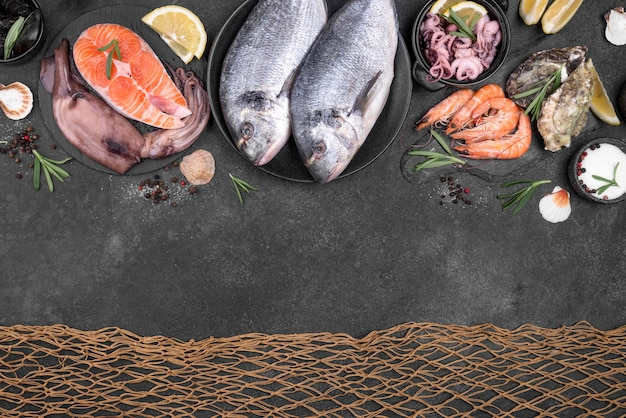 Fish net and seafood on dark background Premium Photo