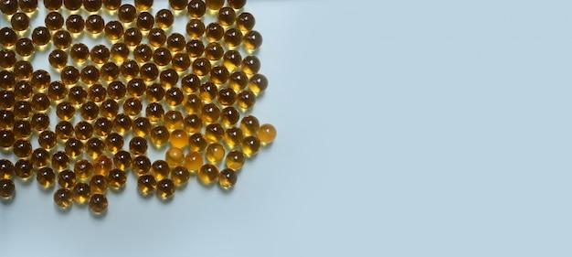 Fish oil, cod liver oil omega 3 gel capsules on blue Premium Photo