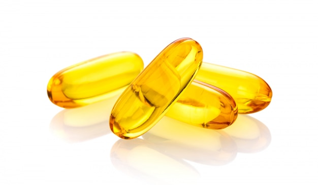Fish oil supplement capsules isolated on white background Premium Photo