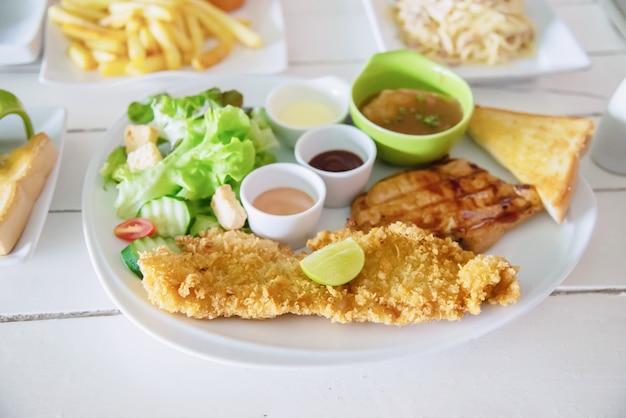 Fish pork and chicken steak meal set Free Photo