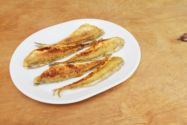 Fish smelt fried in a plate. top view Premium Photo