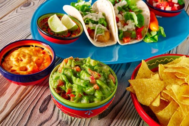 Fish tacos mexican food guacamole nachos and chili Premium Photo