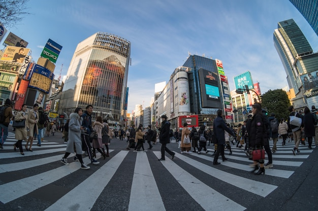 Fisheye scene of undefined people and car crowd are walking on pedestrains intersection Premium Photo