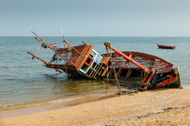 Fishing boat crashed lies on its side Premium Photo