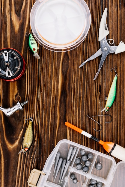 Fishing equipments on wooden background texture Free Photo