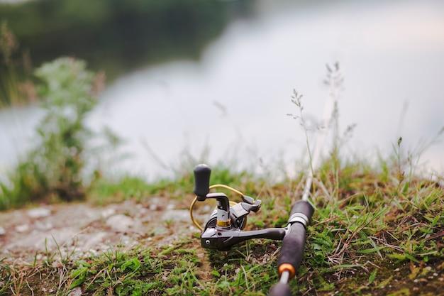 Fishing rod on green grass Free Photo