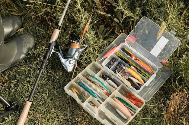 Fishing tool box on the ground Premium Photo