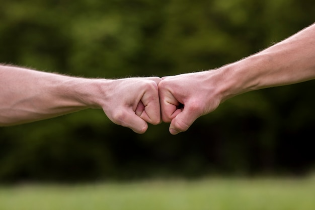 Fist bump welcome gesture Free Photo