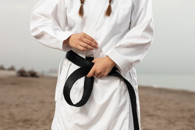 Fit athlete in martial arts costume Free Photo