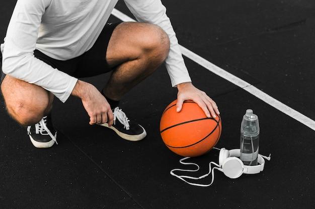 Fit basketball athlete training outdoors Free Photo