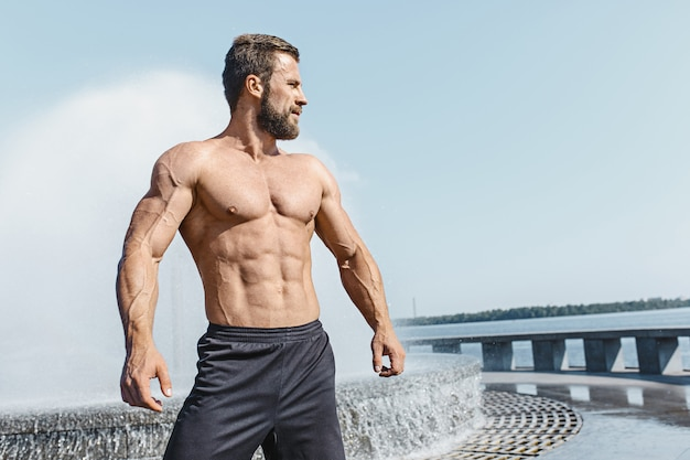 Fit fitness man posing at city Free Photo