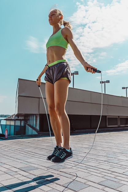 Fit fitness woman doing fitness exercises outdoors Free Photo