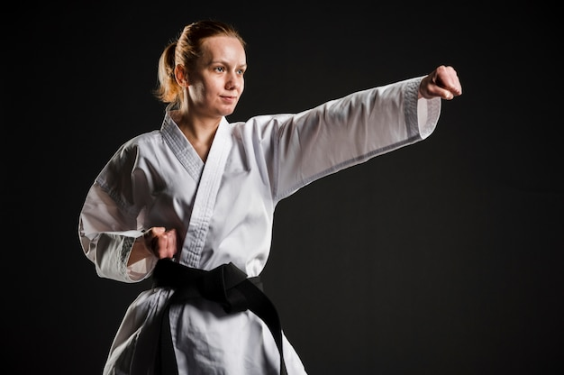 Fit karate woman practicing medium shot Premium Photo