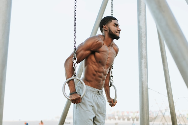 Fit man working out at the beach Premium Photo