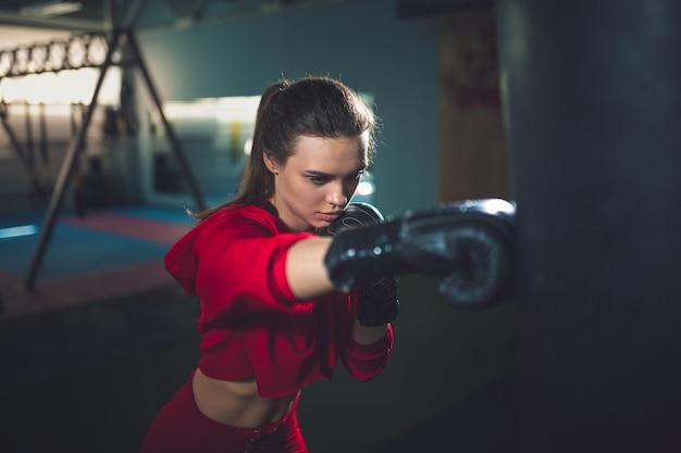 Fit slim young beautiful brunette woman boxing in sportswear Premium Photo
