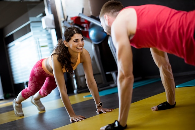 Fit sportive man and woman doing plank core exercise Premium Photo
