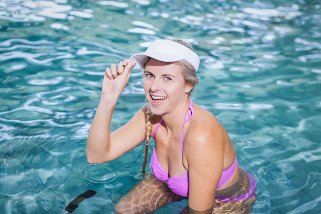 Fit woman doing underwater bike at the pool Premium Photo