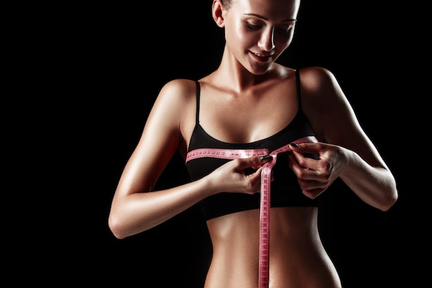 The fit woman measuring perfect shape of beautiful body. healthy lifestyles concept Free Photo