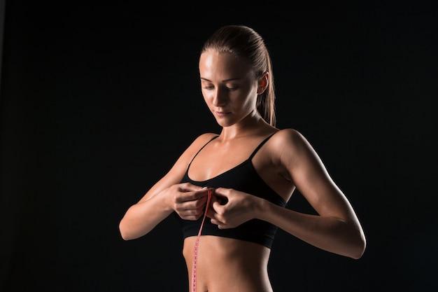 Fit woman measuring perfect shape of beautiful body Free Photo