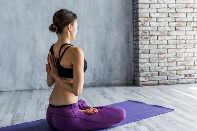 Fit woman meditating Free Photo
