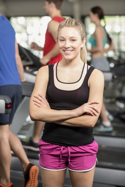 Fit woman posing with arms crossed at gym Premium Photo