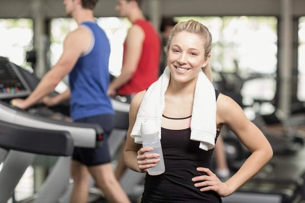 Fit woman posing with hands on hips at gym Premium Photo