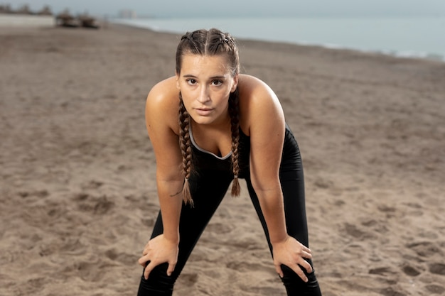 Fit young athlete exercising in sportswear Free Photo