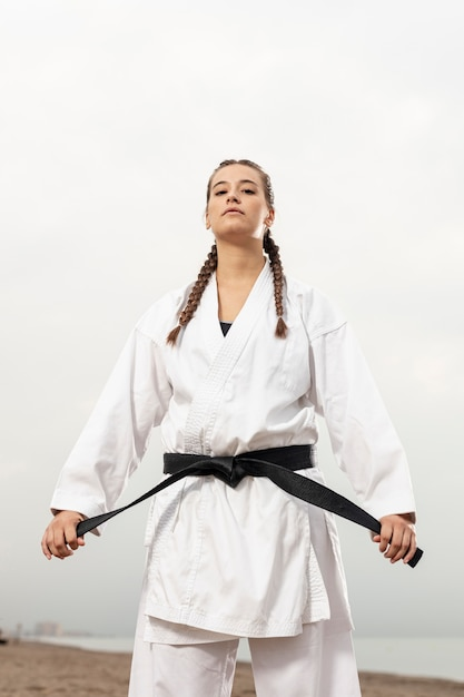 Fit young girl in karate costume Free Photo