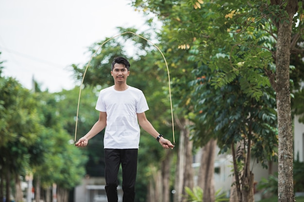 Fit young man with jump rope in a park Premium Photo