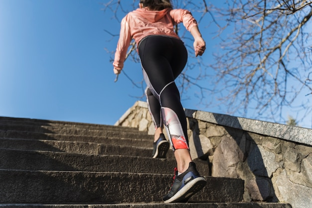 Fit young woman climbing stairs outdoor Free Photo